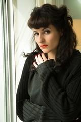 Melancholic Girl at the Window