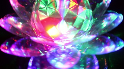 Spinning crystal lotus flower LED light at night
