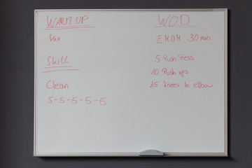whiteboard with fitness instructions
