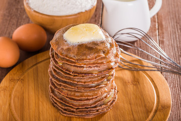 Homemade chocolate pancakes with butter