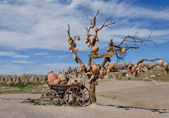 Picturesque landscape with jugs on a tree, Cappadocia in Turkey.