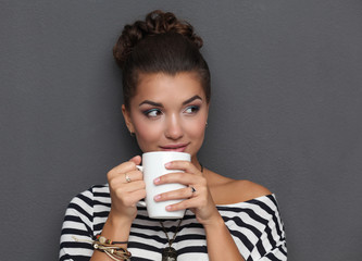 Portrait of a young woman with cup  tea or coffee, isolated on