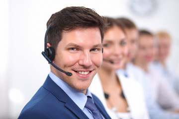 Attractive positive young businesspeople and colleagues in a
