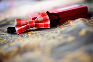 Bow tie with red squares on a nice background