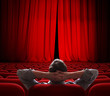 cinema screen red curtains slightly open for vip person - 78541402