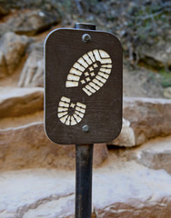 Hiking boot sign on trail