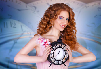 beautiful woman holding a large clock. beauty portrait of cheerf