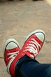 Red shoes on the background of the cement.