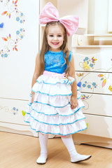 beautiful girl in the image of the doll. Photography in interior