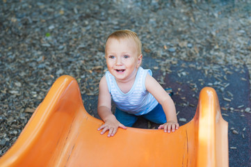 Adorable toddler boy having fun outdoors