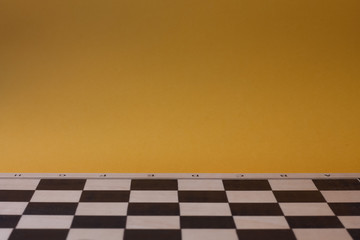 Chessboard with yellow background.
