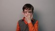 angry teenager boy wears glasses