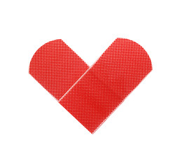 Medical patch as heart symbol isolated on white