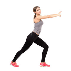 Young sporty woman stretching and exercising