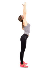 Slim sporty fit woman stretching back with raised arms
