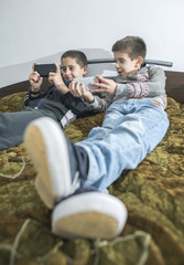 Children playing with their smartphones.
