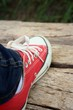 Red shoes on a background of brown wooden