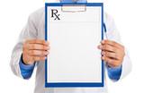 Doctor holding prescription paper