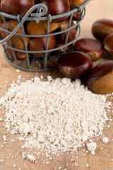 chestnut flour on wooden table