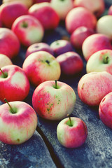 fresh red apples on wooden surface