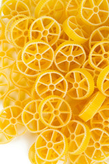 Ruote pasta isolated on white background