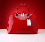 Red handbag on a red background
