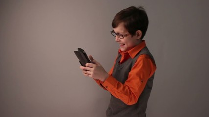 boy teenager playing tablet with glasses