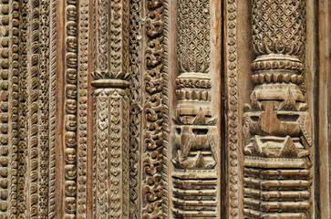 carvings on the frame of door