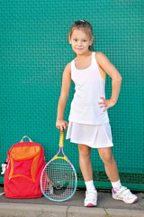 portrait of a little girl on the tennis court