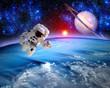 Leinwanddruck Bild - Astronaut Spaceman Saturn Planet