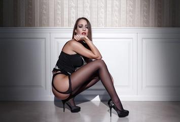 Sensual woman in underwear squat at night