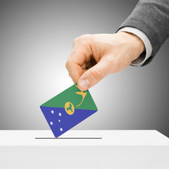 Voting concept - Male inserting flag into ballot box - Christmas