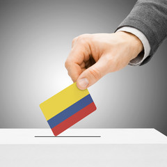 Voting concept - Male inserting flag into ballot box - Colombia