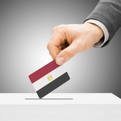 Voting concept - Male inserting flag into ballot box - Egypt