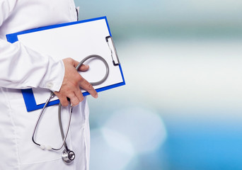 Detail of a doctor holding a clipboard and stethoscope