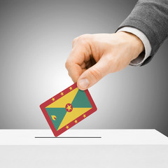 Voting concept - Male inserting flag into ballot box - Grenada