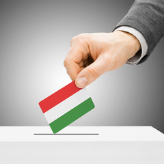 Voting concept - Male inserting flag into ballot box - Hungary