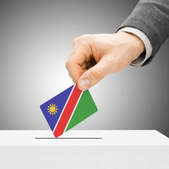 Voting concept - Male inserting flag into ballot box - Namibia
