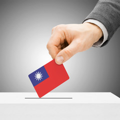 Voting concept - Male inserting flag into ballot box - Republic
