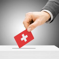 Voting concept - Male inserting flag into ballot box - Switzerla