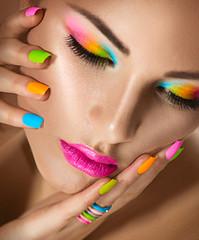 Beauty girl portrait with vivid makeup and colorful nailpolish