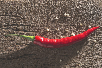 Red hot peppers on wooden  cutting board