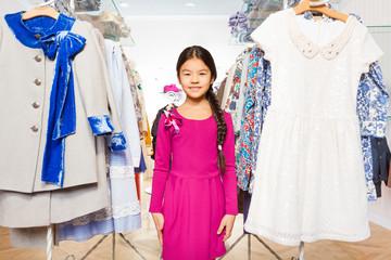 Asian girl with beautiful braid between hangers
