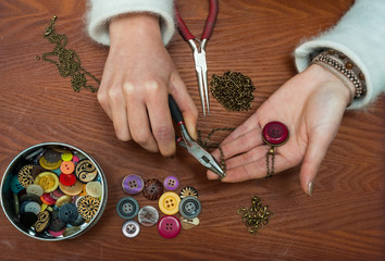 woman making craft jewellery