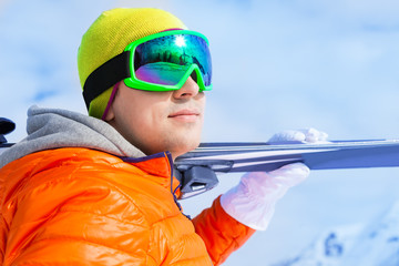 Close-up view of young man wearing mask in winter