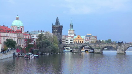 The Old Town with Charles bridge tower in Prague in the evening
