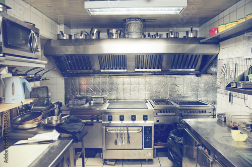 Plexiglas Koken Typical kitchen of a restaurant, toned