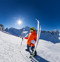 Young man standing with ski near in snow