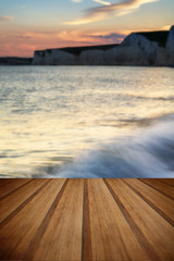 Landscape image of sunset over Birling Gap in England with woode