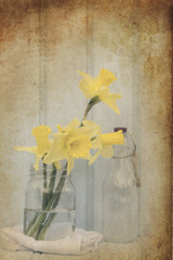 Still life image of Spring flowers with vintage texture filter e